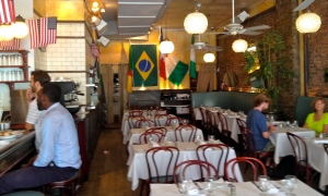 Harlem's Chez Lucienne isn't a big soccer spot, but they have embraced the World Cup by displaying flags and broadcasting the games for the local lunchtime crowd.