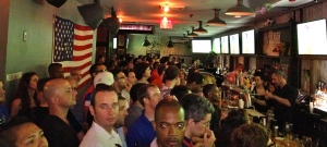 The crowd inside Smithfield Hall watches the USA cling to a tie with Belgium