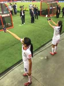Costa Rica's Wendy Acosta (20) and Melissa Herrera (7) selfie-brate the Ticas' hard-fought tie against South Korea in Montreal.