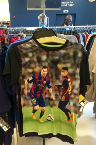 A weird polyester poster t-shirt featuring Messi and Neymar.